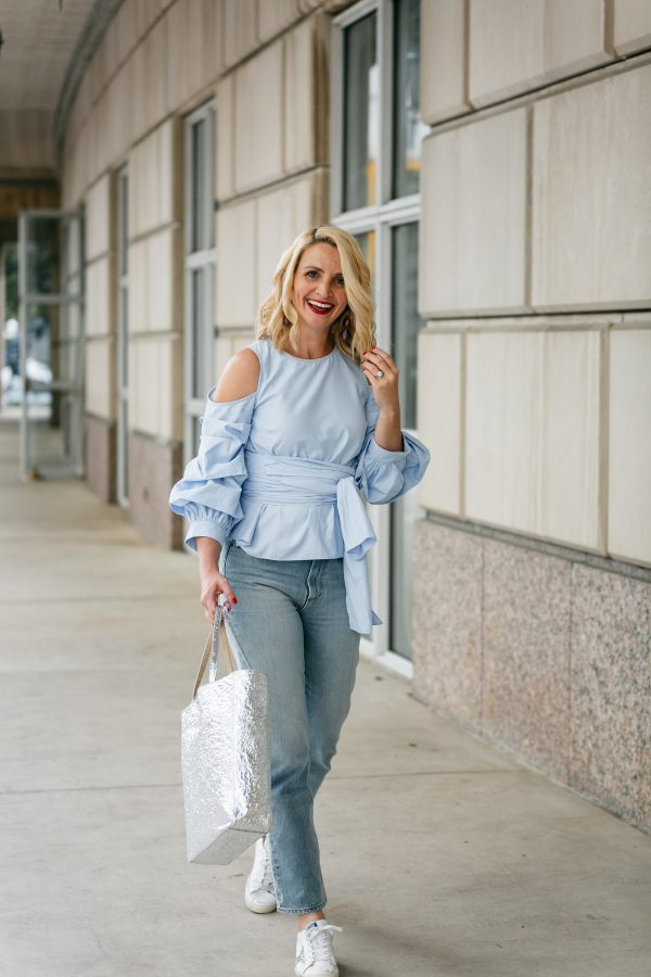 JOA statement sleeve blouse, Elizabeth and James metallic silver bag, high waisted denim, how to wear golden goose sneakers, wrap blouse outfit idea