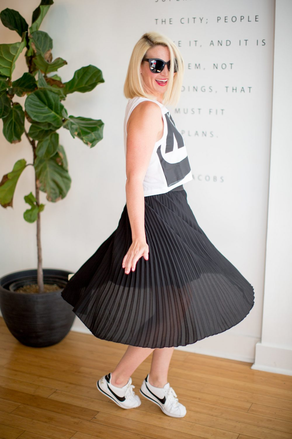 black midi skirt on kate brennan of the chic series paired with sneakers