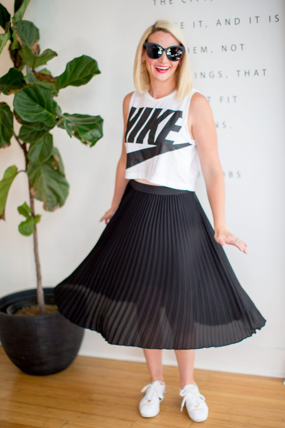 how to pair sneakers with a dress or a skirt: black midi skirt